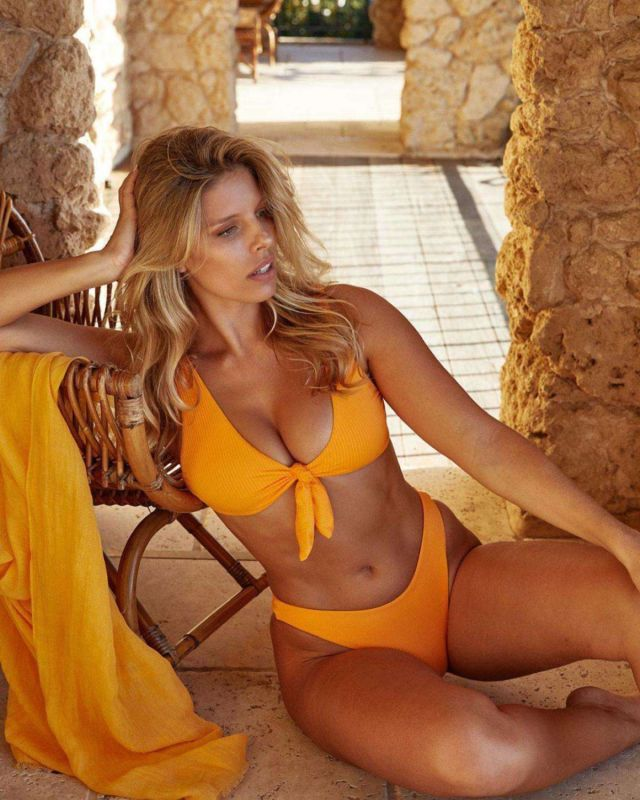Natasha Oakley's Photoshoot In An Orange Bikini