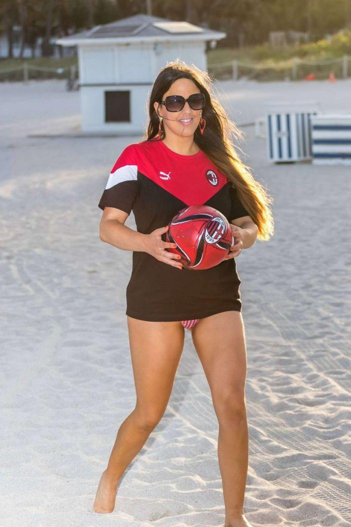 Claudia Romani in beach sporty bikini photoshoot